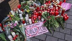 Flowers and candles at one of the places of the shooting in Hanau, Germany.