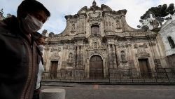 Man walking by a church closed due to the pandemic in Quito, Ecuador