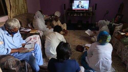 A Pakistani Christistian family in Karachi following an online prayer service during the Covid-19 lockdown.