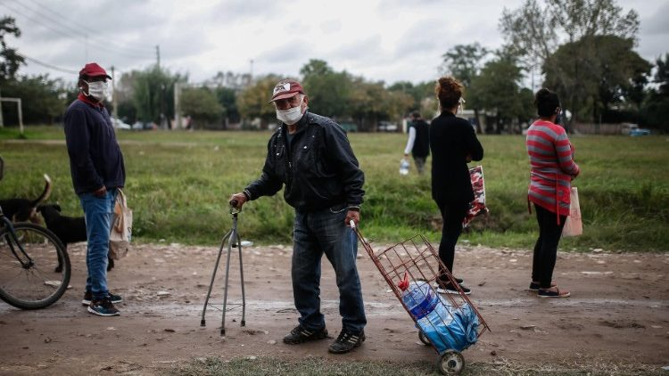 Argentinian people receive food during a day of quarantine