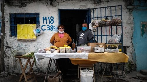 People sell food outside their home in a neighbourhood in Buenos Aires, Argentina