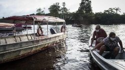 Medical aid against COVID-19 arrives by boat to the riverside of the Brazilian Amazon