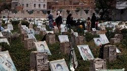 Yemenis at a graveyard in Sana'a