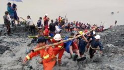 Rescue operation under way at a landslide in Myanmar's Kachin State on July 2, 2020.