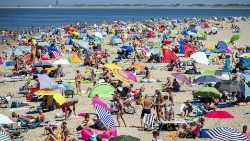 Sunbathers crowd a beach near Brouwersdam in The Netherlands