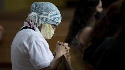 "The faithful pray on Sunday during the ""Day of Prayer and Silence"" organised after an attack on the Managua Cathedral"