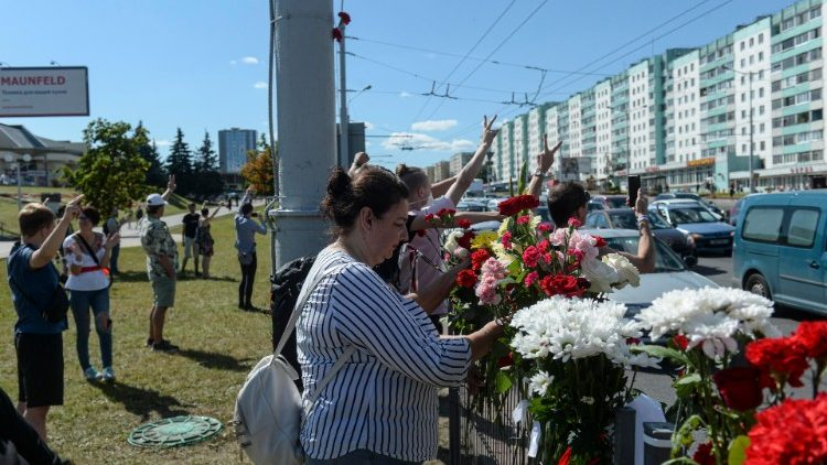 People lay flowers where a protester died in Minsk, Belarus