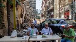 Beirut citizens have breakfast in the city's devastated port area