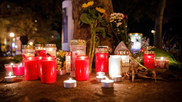 Candles and flowers near the crime scene after multiple shootings in Vienna