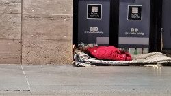 A homeless person sleeps rough near Rome's main train station