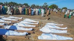 Nigerian mourners attend the mass burial of farm workers killed in an attack at Zabarmari, Borno State