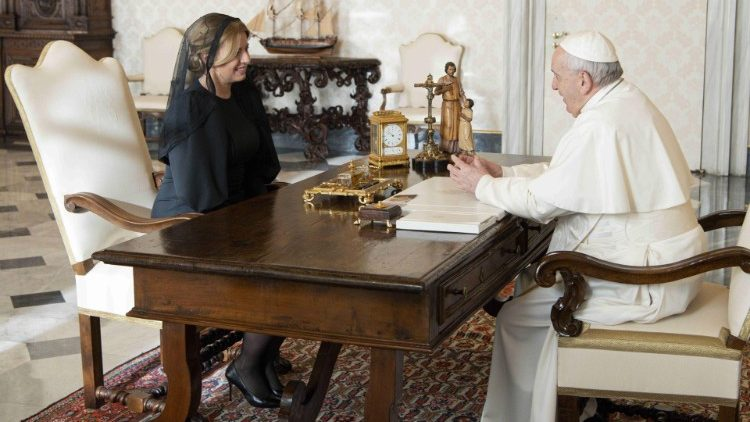 Pope Francis speaks with President Zuzana Čaputová during their audience in the Apostolic Library.