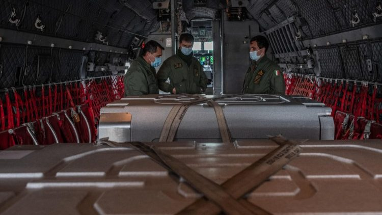 A shipment of Covid-19 vaccines in the cargo hold of a plane