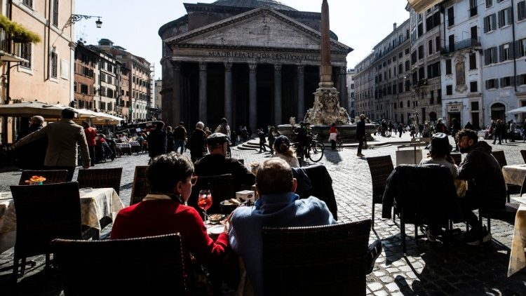People enjoy Sunday leisure time near the Pantheon in Rome, Italy