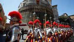 Swiss guards parade outside the Vatican Bank