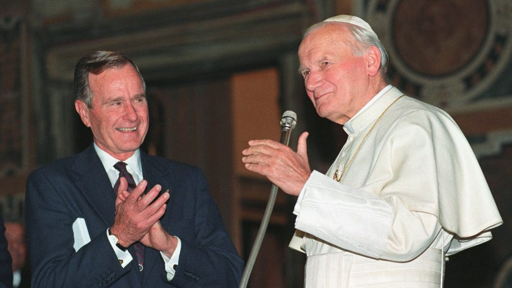 FILE PHOTO: U.S. President George H.W. Bush applauds Pope John Paul II after a welcoming ceremony prior to their audience at the Vatican