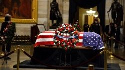 Casket of late President HW Bush departs Capitol