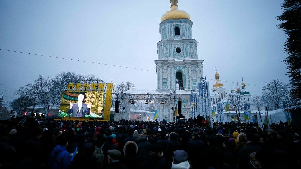Ukrainian believers gather at the front of the Saint Sophia's Cathedral in Kiev