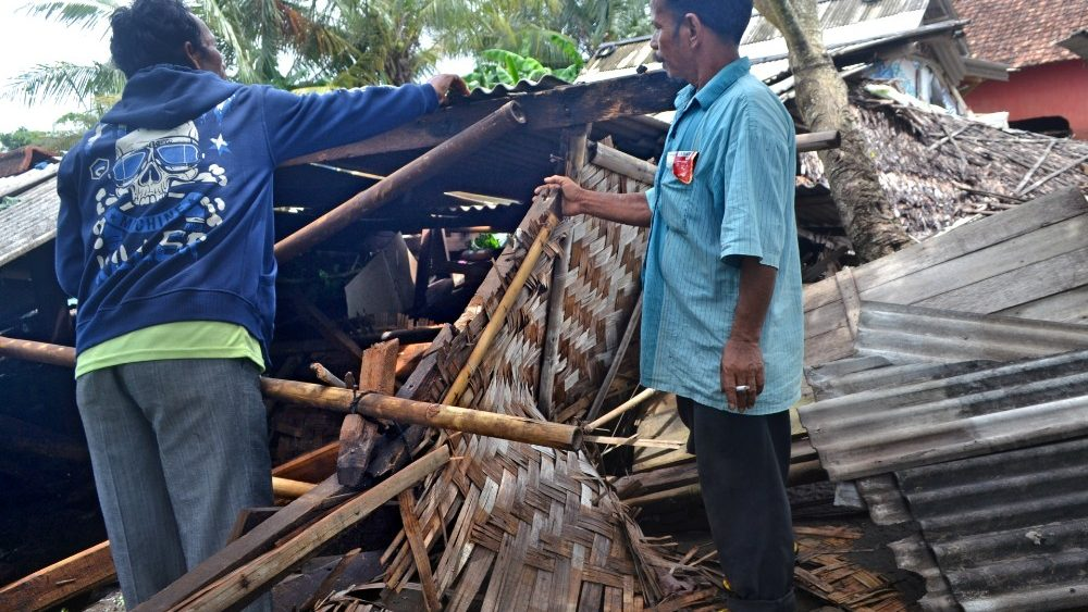 residents-collect-debris-from-their-collapsed-1545551929405.JPG