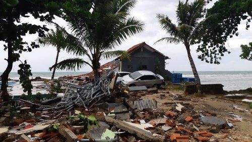 A car is seen among ruins after a tsunami hit Carita beach in Pandeglang, Banten province