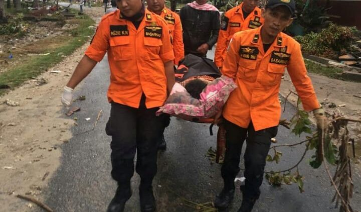 rescue-team-members-carry-a-victim-on-a-stret-1545559435156.JPG