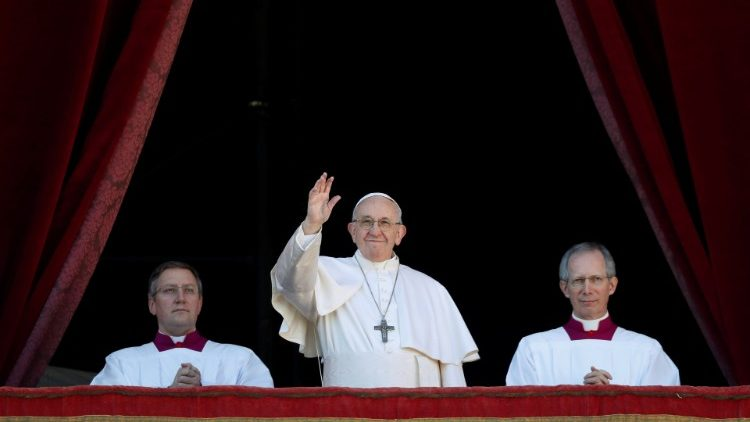 "Pope Francis waves after delivering the ""Urbi et Orbi"" message from the main balcony of Saint Peter's Basilica at the Vatican"