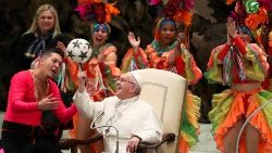 pope-francis-plays-with-a-ball-as-members-of--1546424932984.JPG