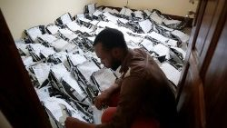 A man classifies voting materials at CENI tallying centre in Kinshasa
