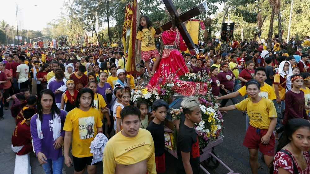 Catholic devotees wait to touch the statue of the Black Nazarene on its feast day in Manila