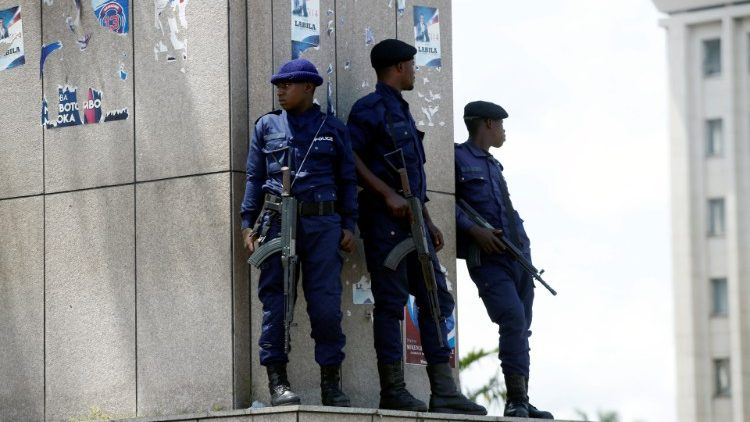 Congolese policemen take positions near Congo's Independent National Electoral Commission (CENI) headquarters in Kinshasa