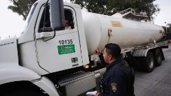 A police officer talks to a fuel truck driver in Mexico City