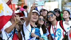 Pilgrims from the Philippines take a selfie ahead of Pope Francis visit for World Youth Day in Panama City