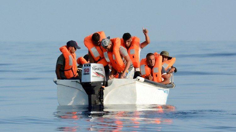 file-photo--migrants-are-seen-on-board-a-fibe-1548256754932.JPG
