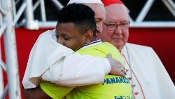 Pope Francis hugs a WYD volunteer