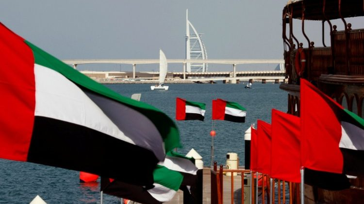 FILE PHOTO: UAE flags fly as the Burj al-Arab luxury hotel is seen in the background during the UAE's National Day in Dubai