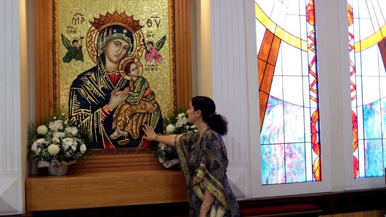 Mina Liccione, a Catholic Christian married to local Muslim Ali al Sayed, prays at St. Francis of Assisi Catholic church at Jebel Ali, in Dubai