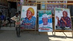 Boys near campaign posters for candidates running for office in the 16 Feb. elections, at the Teachers' Village IDP camp in Maiduguri