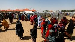 Women queue for relief at the Teachers' Village IDP camp in Maiduguri