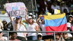 women-hold-a-venezuelan-flag-and-a-sign-as-th-1549344834215.JPG