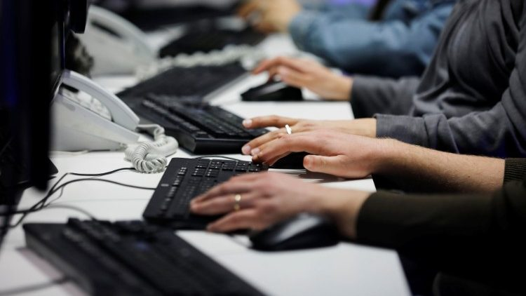 Employees, mostly veterans of military computing units, use keyboards as they work at a cyber hotline facility at Israel's Computer Emergency Response Centre (CERT) in Beersheba, southern Israel
