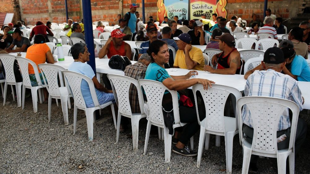 people-wait-to-have-lunch-at-an-aid-center-an-1551298236289.JPG