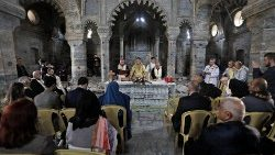 A Bishop delivers a mass at St. Thomas of Syriac Catholic church in the old city of Mosul