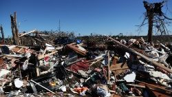Debris lays outside a house devastated after two deadly back-to-back tornadoes, in Beauregard, Alabama