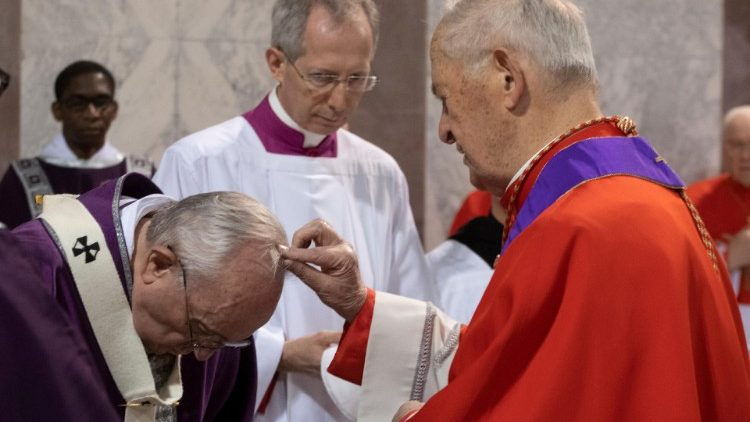 Pope Francis is sprinkled with ashes by cardinal Jozef Tomko during the Ash Wednesday mass at the Santa Sabina Basilica in Rome