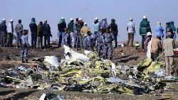 Ethiopian Federal policemen stand at the scene of the Ethiopian Airlines Fligh plane crash