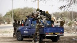 FILE PHOTO: Chadian soldiers sit in a military pickup truck in Damasak