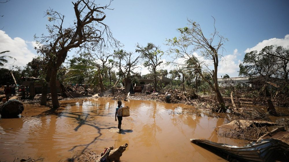 a-child-walks-past-debris-as-flood-waters-beg-1553448556766.JPG