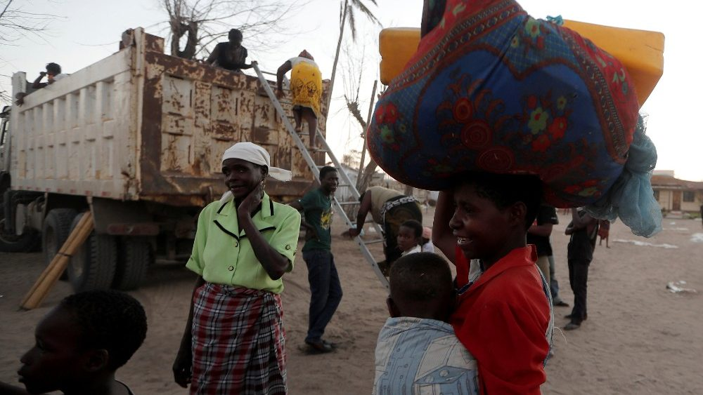 displaced-people-arrive-at-a-camp-in-the-afte-1553971170135.JPG