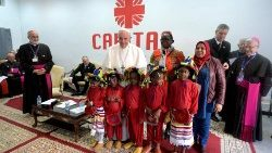 Pope Francis poses for a picture at Caritas' office in Morocco