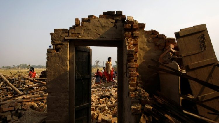 villagers-stand-on-the-debris-of-the-houses-a-1554181134866.JPG